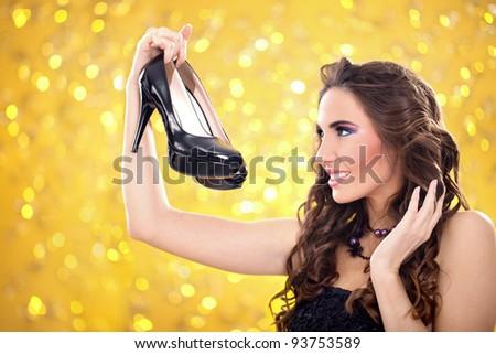 woman looking in her elegant pair of high heels - stock photo