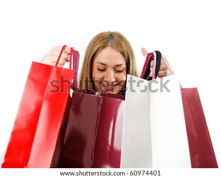 Woman looking in shopping bags smiling,isolated on white - stock photo