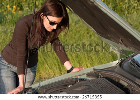 woman looking in the broken engine