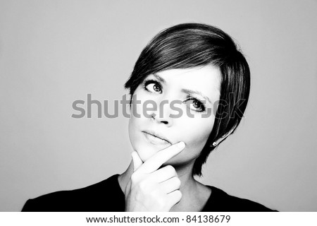 woman looking like shes deep in thought - stock photo