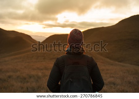 Woman looking out into the horizon. - stock photo