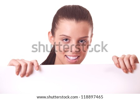 woman looking out of blank board or paper on white background - stock photo