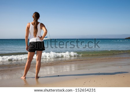 Woman looking out to sea - stock photo