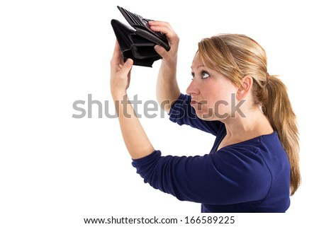Woman looking sad at an empty wallet - stock photo