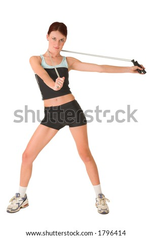 Woman looking serious in gym wear holding skipping rope.
