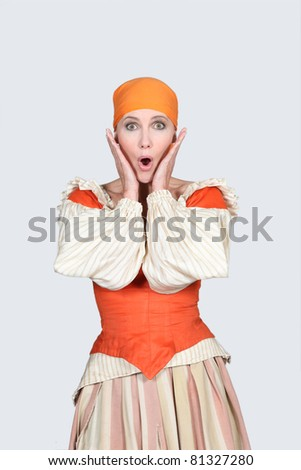 Woman looking shocked - stock photo