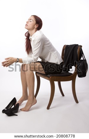 Woman looking stressed out after a long day - stock photo