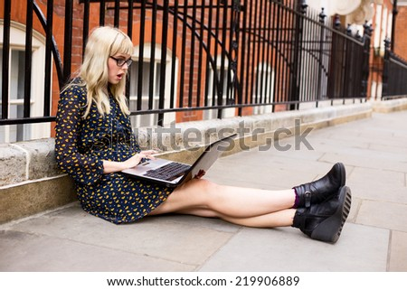 woman looking surprised at laptop. - stock photo