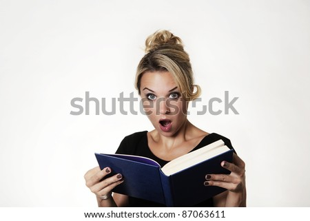 woman looking surprised read in a book