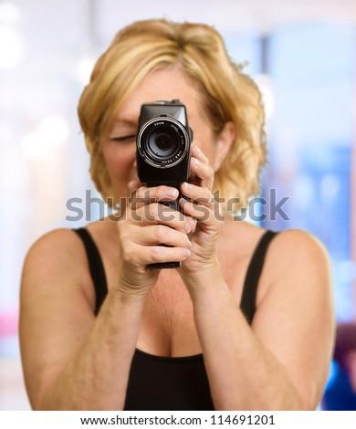 Woman Looking Through An Camera, Indoor - stock photo