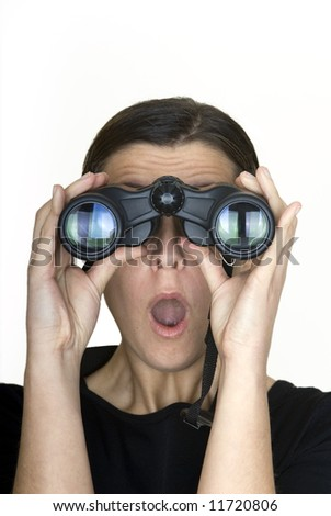 woman looking through binoculars with surprised expression - stock photo