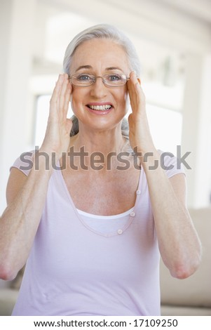 Woman Looking Through New Glasses - stock photo