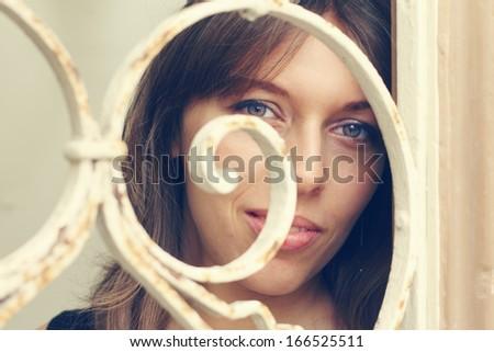 woman looking through the vintage door - stock photo