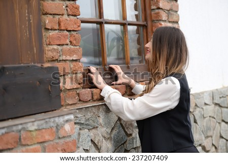 Woman looking thru window