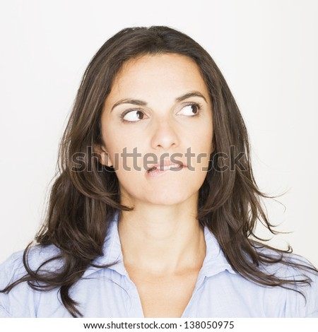 woman looking to her left with a grimace - stock photo