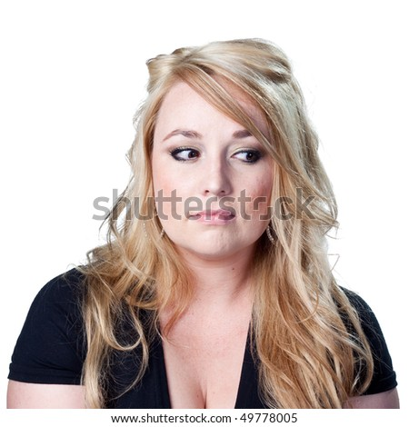 Woman looking to the side, wondering about her options - stock photo