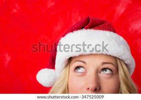 Woman looking up at her red hat