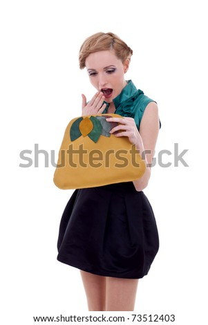Woman looking very amazed into her purse, over white - stock photo