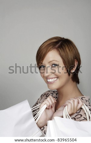 woman looking very happy with herself with all the shopping she done - stock photo