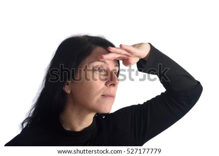 Woman looking with hand on forehead