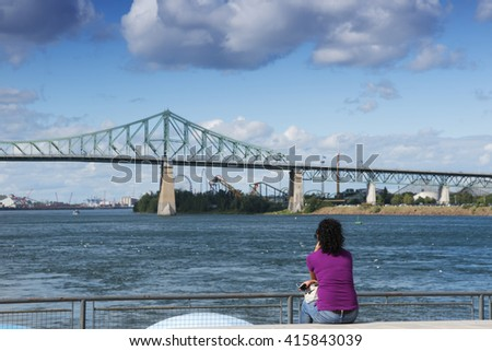 woman looks at Vie Port, Montreal, Quebec, Canada - stock photo