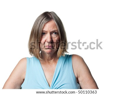 Woman looks sad and dejected, upset at something - stock photo