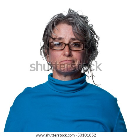 Woman looks sad with tears in her eyes - stock photo
