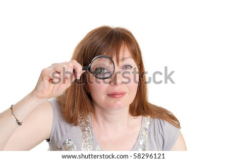 woman looks through a magnifier