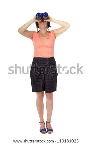 Woman looks through binoculars - stock photo