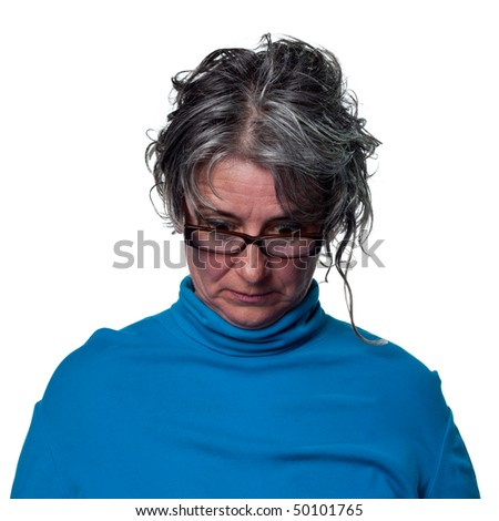 Woman looks to the floor and stares - stock photo