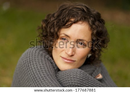 Woman lost in thought - stock photo