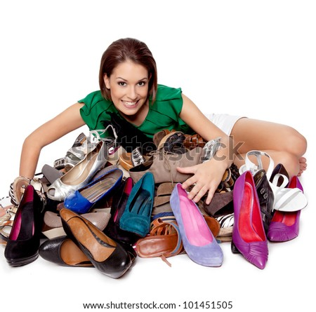 Woman loves her shoes, she is proud of her huge collection of any kind of shoes - stock photo