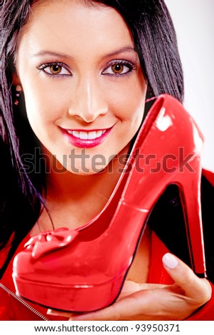 Woman loving her red high-heels and smiling - isolated over a white background - stock photo