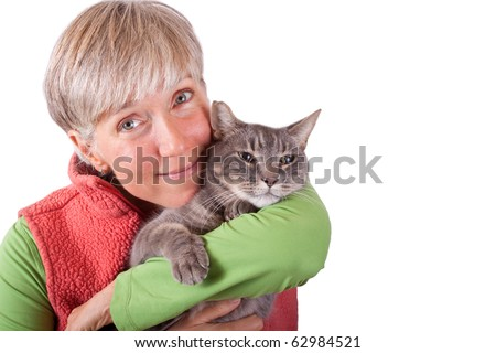 woman lovingly hugging grey cat on white