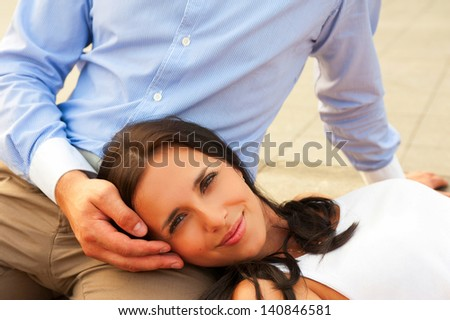 woman lying at mans knees