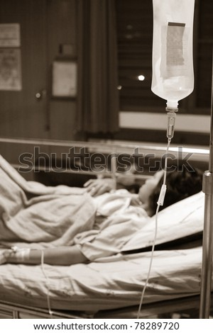 Woman Lying Down In Hospital Bed - stock photo