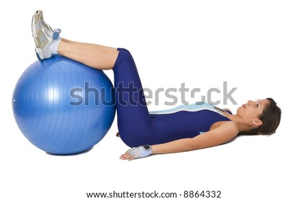 Woman lying down with a gym ball- interesting and unusual perspective.