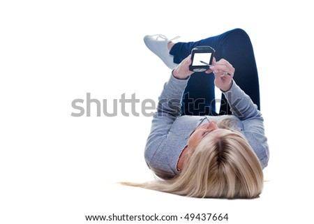 Woman lying down writing on her pda isolated on a white background, space on the screen for your own message.