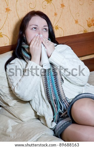 Woman lying in bed with flu - stock photo