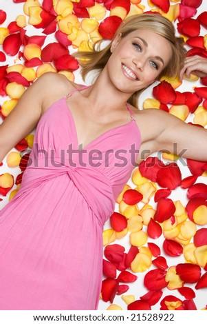 Woman Lying in Rose Petals - stock photo