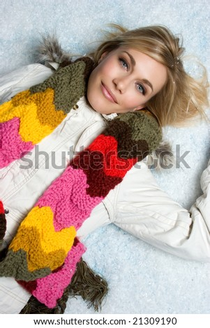 Woman Lying in Snow - stock photo