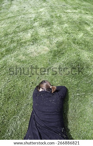 Woman lying in the grass, rest and relaxation, zen - stock photo