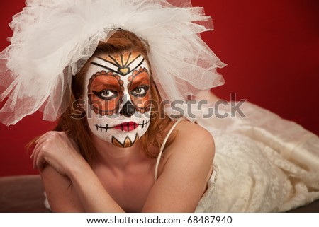 Woman Lying on Floor with Bridal Makeup for All Souls Day - stock photo