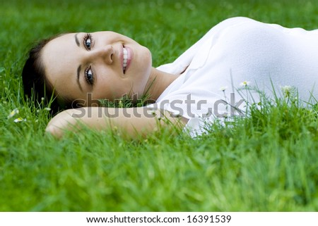 Woman lying on grass - stock photo