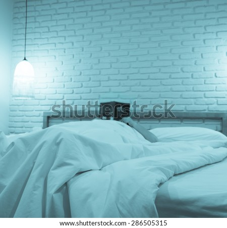 woman lying on the bed reading a book, image blur - stock photo
