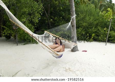 Woman lying on the hammock - stock photo