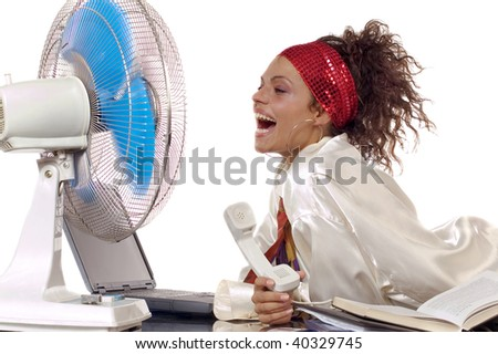 Woman lying on the table with ventilator, laptop and phone - stock photo