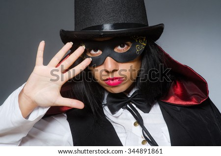 Woman magician in funny concept - stock photo