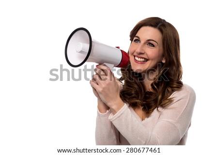 Woman make advertising with loudhailer  - stock photo