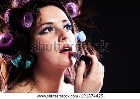 Woman make up, hair with curlers and lipstick